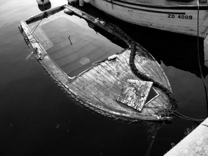 sinking_boat_by_aerendial.jpg